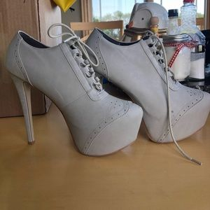 Pointed toe lace up heels